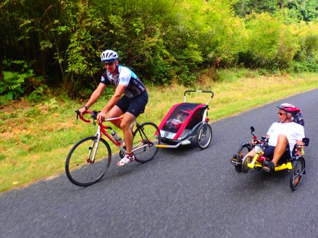 My dad riding his trike, with Luke and Liesel pulling ahead.