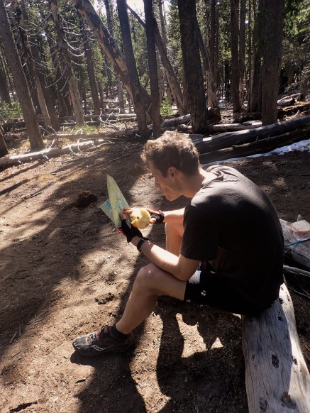 Andrew deeply concentrating on the map.