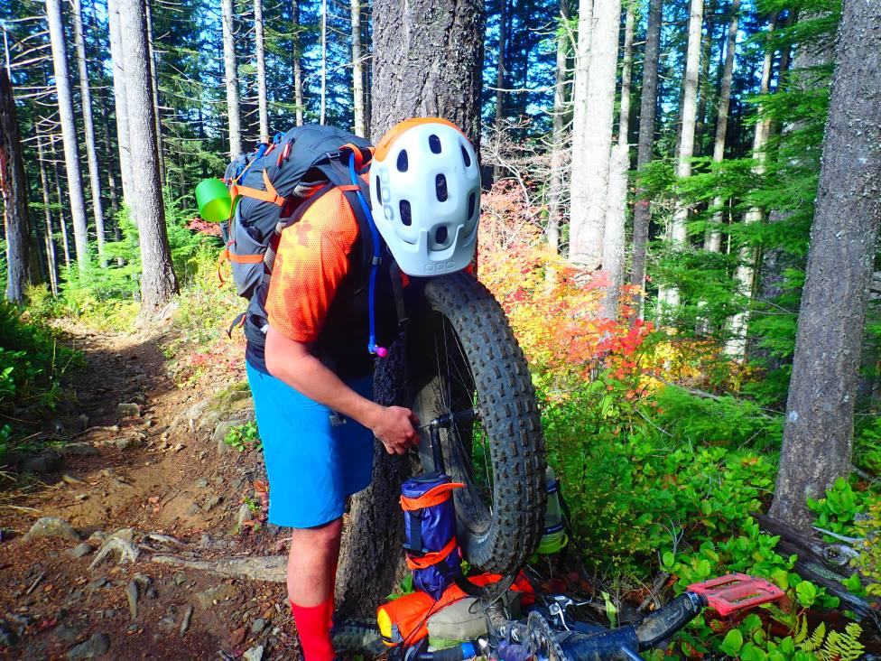 The only mechanical of the trip. Pumping up a fat tire that is flat is a three-person effort, it turns out.